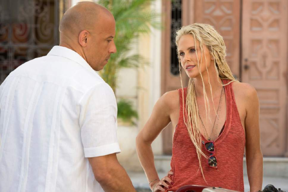 """This image released by Universal Pictures shows Charlize Theron, right, and Vin Diesel in """"The Fate of the Furious."""" (Universal Pictures via AP)"""