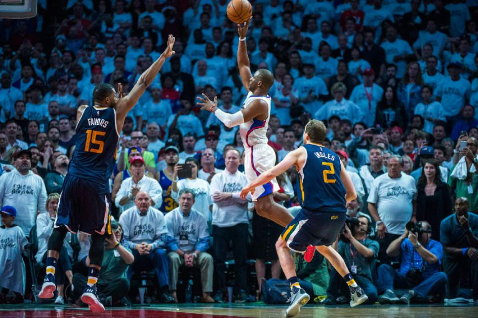 Chris Detrick     The Salt Lake Tribune LA Clippers guard Chris Paul (3) shoots the game-tying shot past Utah Jazz forward Derrick Favors (15) during Game 1 of the Western Conference at the Staples Center Saturday, April 15, 2017.  Utah Jazz defeated LA Clippers 97-95.