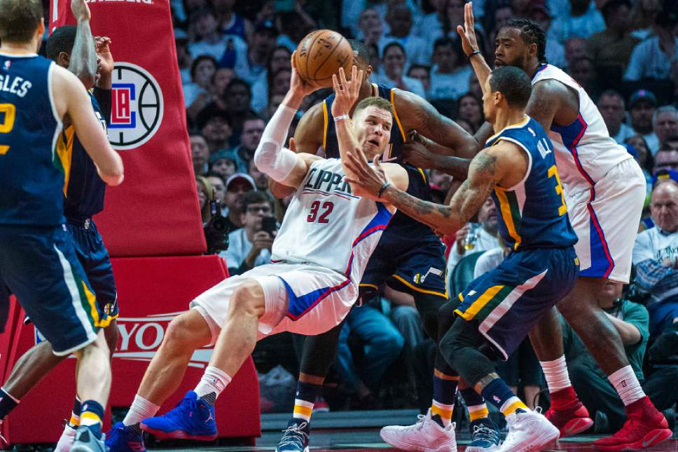 Chris Detrick     The Salt Lake Tribune Utah Jazz forward Derrick Favors (15) and Utah Jazz guard George Hill (3) guard LA Clippers forward Blake Griffin (32) during Game 1 of the Western Conference at the Staples Center Saturday, April 15, 2017.  Utah Jazz defeated LA Clippers 97-95.