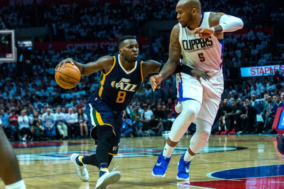 Chris Detrick     The Salt Lake Tribune Utah Jazz guard Shelvin Mack (8) runs past LA Clippers center Marreese Speights (5) during Game 1 of the Western Conference at the Staples Center Saturday, April 15, 2017.  Utah Jazz defeated LA Clippers 97-95.