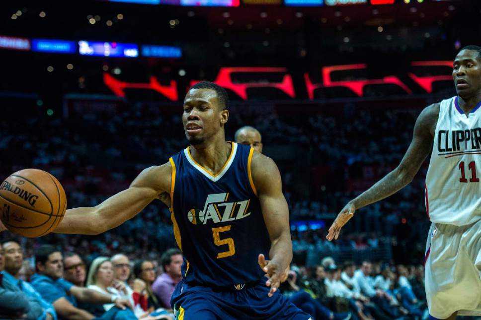 Chris Detrick     The Salt Lake Tribune Utah Jazz guard Rodney Hood (5) grabs the ball past LA Clippers guard Jamal Crawford (11) during Game 1 of the Western Conference at the Staples Center Saturday, April 15, 2017.  Utah Jazz defeated LA Clippers 97-95.