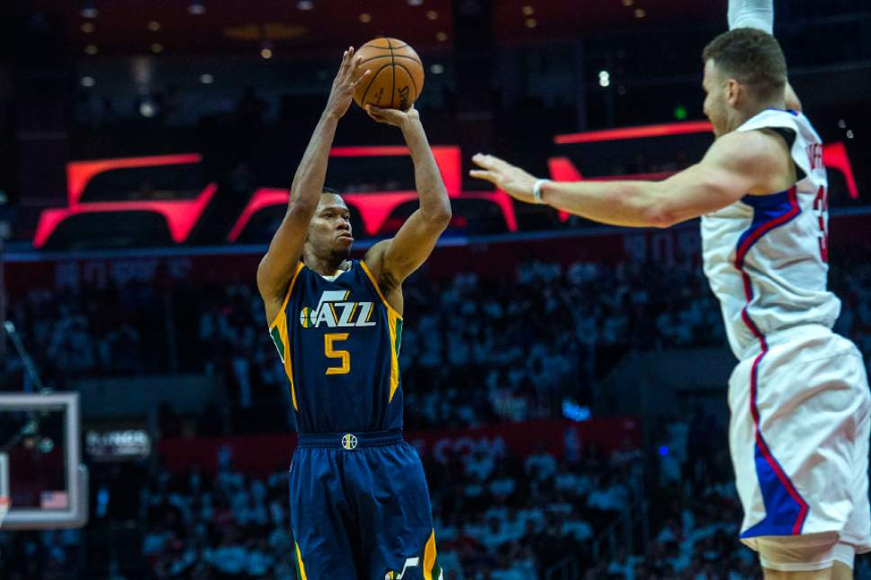 Chris Detrick     The Salt Lake Tribune Utah Jazz guard Rodney Hood (5) shoots past LA Clippers forward Blake Griffin (32) during Game 1 of the Western Conference at the Staples Center Saturday, April 15, 2017.  Utah Jazz defeated LA Clippers 97-95.