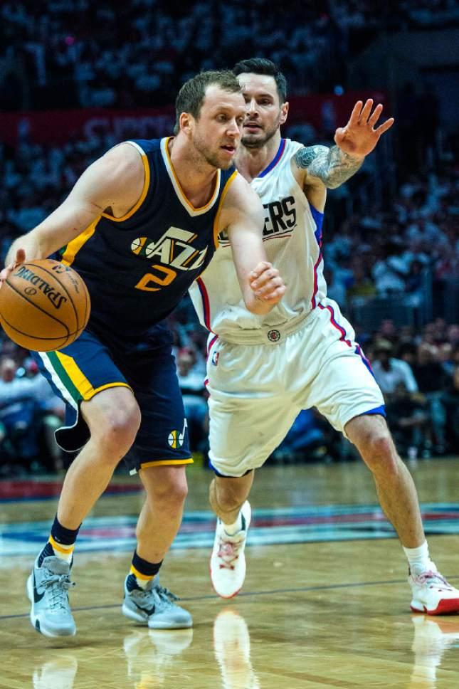 Chris Detrick     The Salt Lake Tribune Utah Jazz forward Joe Ingles (2) runs past LA Clippers guard JJ Redick (4) during Game 1 of the Western Conference at the Staples Center Saturday, April 15, 2017.  Utah Jazz defeated LA Clippers 97-95.