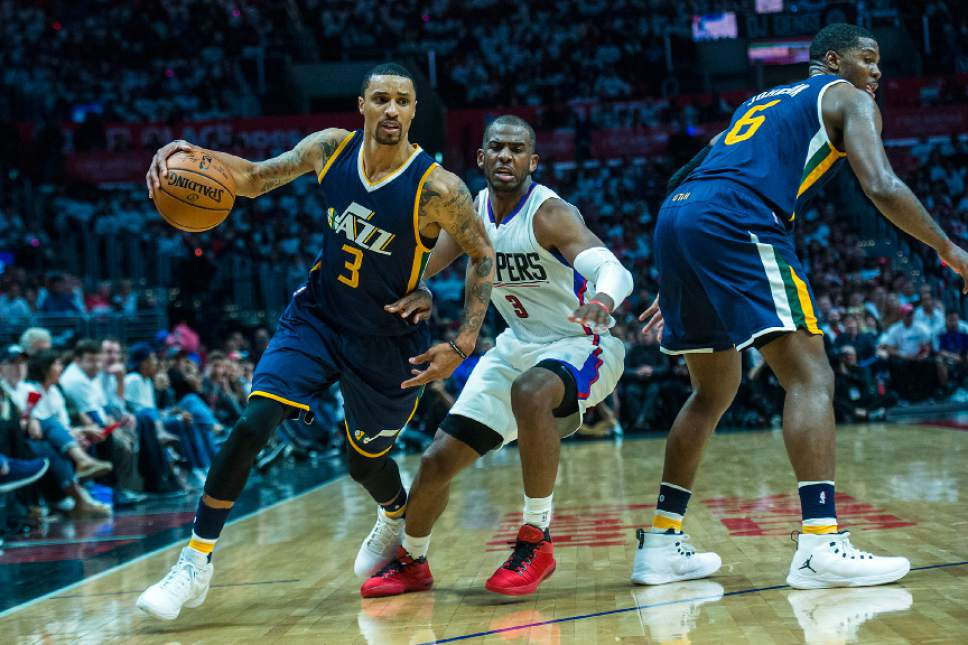 Chris Detrick     The Salt Lake Tribune Utah Jazz guard George Hill (3) runs around LA Clippers guard Chris Paul (3) during Game 1 of the Western Conference at the Staples Center Saturday, April 15, 2017.  Utah Jazz defeated LA Clippers 97-95.