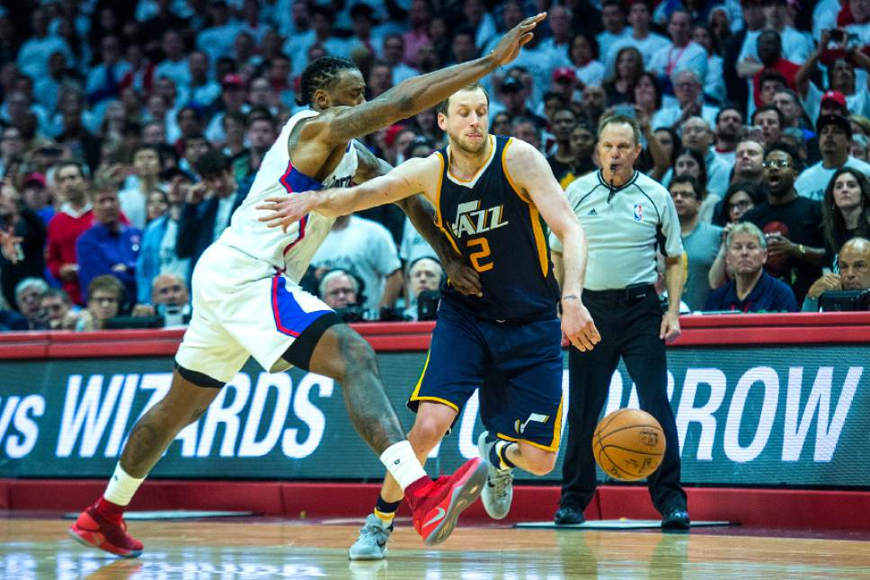 Chris Detrick     The Salt Lake Tribune LA Clippers center DeAndre Jordan (6) tries to steal the ball from Utah Jazz forward Joe Ingles (2) during Game 1 of the Western Conference at the Staples Center Saturday, April 15, 2017.  Utah Jazz defeated LA Clippers 97-95.