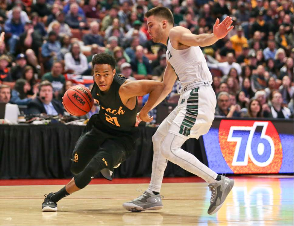 Long Beach State guard Justin Bibbins lowers his shoulder as drives around Hawaii guard Niko Filipovich during the first half of an NCAA college basketball championship game of the Big West conference tournament Saturday March 12, 2016, in Anaheim, Calif. (AP Photo/Lenny Ignelzi)