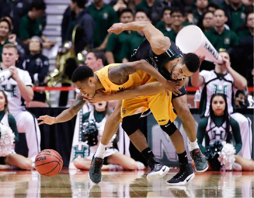 Long Beach State's Justin Bibbins, left, is fouled by Hawaii's Noah Allen during the second half of an NCAA college basketball game at the Big West men's tournament Thursday, March 9, 2017, in Anaheim, Calif. (AP Photo/Jae C. Hong)