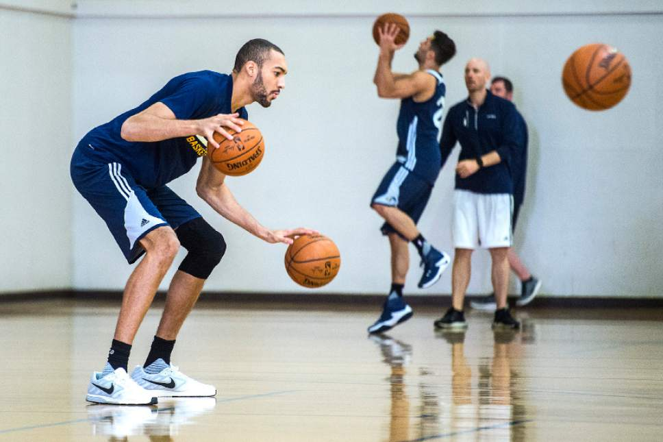 Chris Detrick  |  The Salt Lake Tribune Utah Jazz center Rudy Gobert (27) dribbles two basketballs during a practice at UCLA Student Activities Center Monday, April 17, 2017.