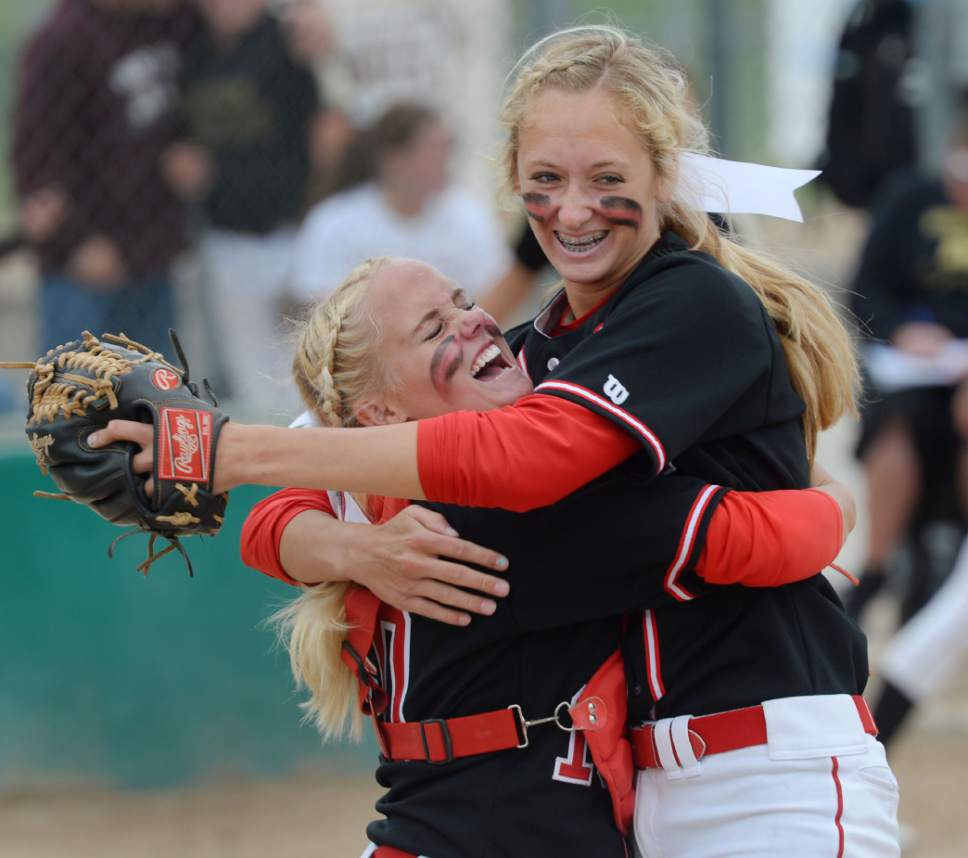Steve Griffin  |  The Salt Lake Tribune   Spanish Fork catcher Whitney Perkins hugs pitcher Cambrie Hazel as she strikes out a batter to end the top of the seventh inning during the 4A softball championship game between Maple Mountain and Spanish Fork at th eValley Softball Complex in Taylorsville, Friday, May 22, 2015.