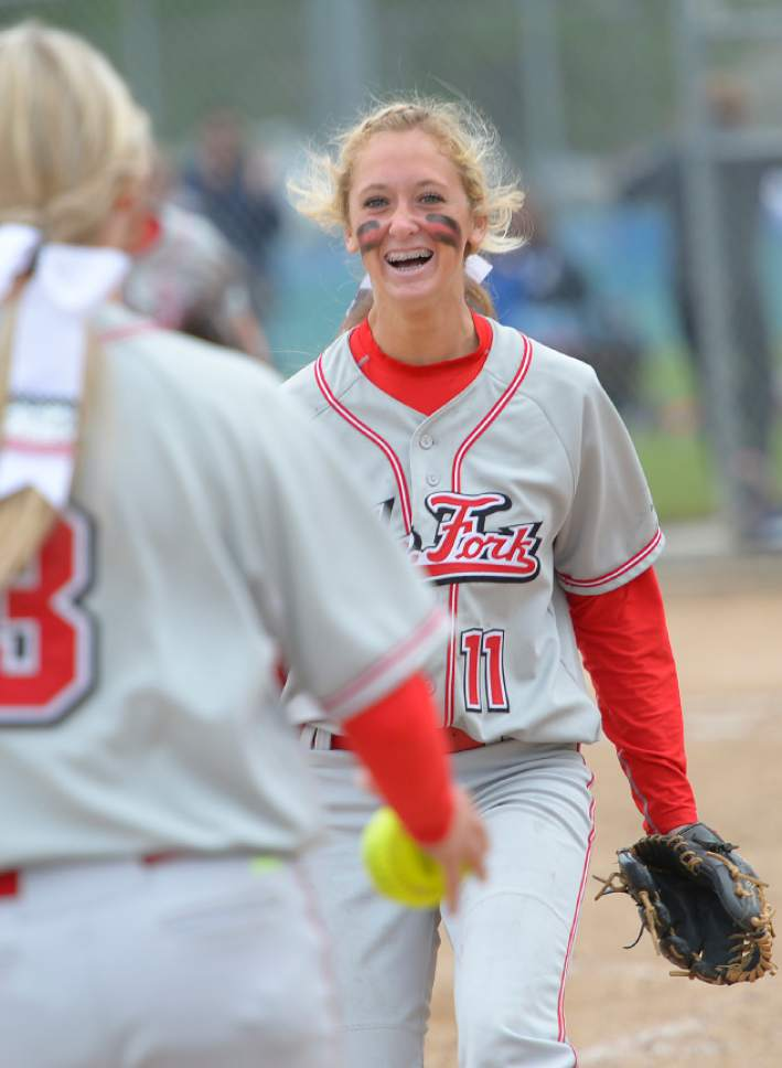 Leah Hogsten  |  The Salt Lake Tribune Spanish Fork pitcher Cambrie Hazel celebrates the win with Kenzie Branch. Spanish Fork High School girls softball team defeated Springville High School 7-1 during their 4A state semifinal game Thursday, May 21, 2015 at the Taylorsville Valley Softball Complex.