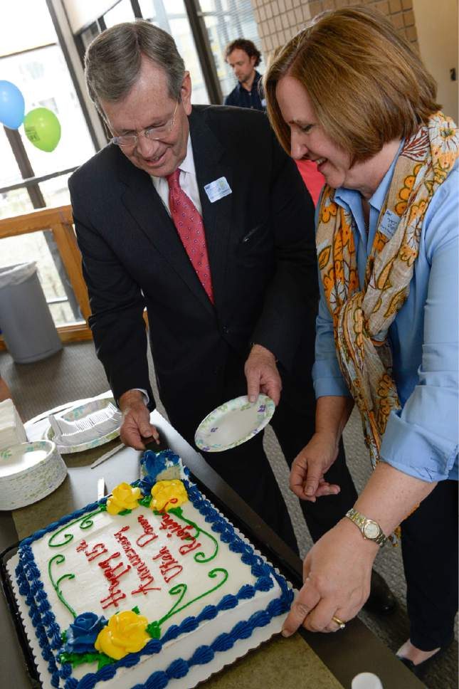 Francisco Kjolseth | The Salt Lake Tribune Former Utah Governor Mike Leavitt is joined by former Utah State Senator Karen Hale as they are given the honor of cutting the cake celebrating the creation of the digital Yes Utah Donor Registry 15 years ago. The two played an instrumental role in making the registry more accessible through online registration.