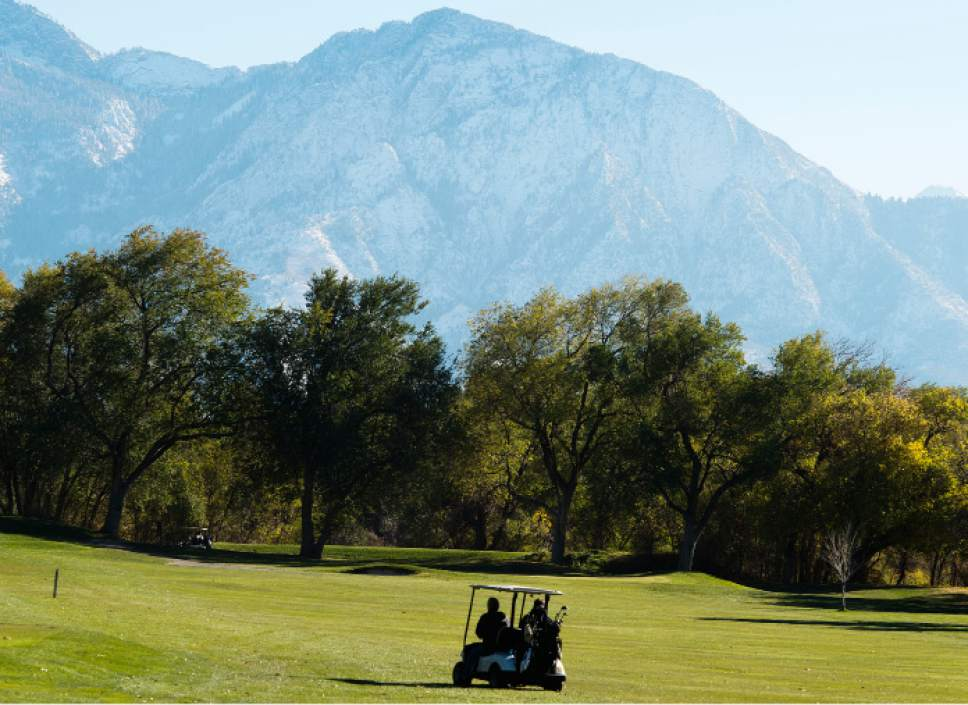 Steve Griffin  |  The Salt Lake Tribune  Snow covers Mount Olympus as golfers enjoy the warm weather at Bonneville Golf Course in Salt Lake City, Friday, November 13, 2015.