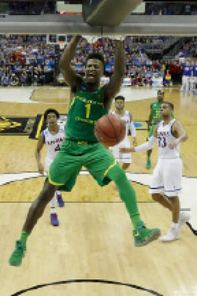 FILE--In this March 25, 2017, file photo, Oregon's Jordan Bell dunks during the NCAA men's college basketball tournament Midwest Regional championship game against Kansas in Kansas City, Mo. Bell has become the latest Ducks player to declare for the NBA draft. (AP Photo/Charlie Riedel, file)