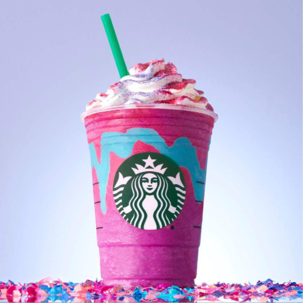 """This photo provided by Starbucks shows the company's """"Unicorn Frappuccino."""" Starbucks says its newest beverage not only changes colors with a stir of the straw, but flavors as well. The Seattle chain says its """"Unicorn Frappuccino"""" starts as a purple drink with blue swirls that tastes sweet and fruity, before changing to pink with a tangy and tart taste with a stir of the straw. The company says the drink is available for a limited time while supplies last, from April 19 to April 23, 2017, in the United States, Canada and Mexico. (Starbucks via AP)"""