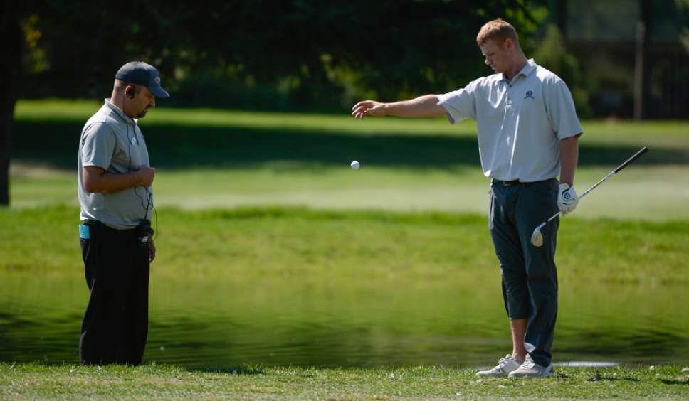 Francisco Kjolseth | The Salt Lake Tribune Patrick Fishburn of Ogden, Utah, is unable to avoid a penalty stroke after removing his shoe to take a shot on the edge of a pond at Riverside Country Club in Provo during the final round of the Utah Open golf tournament on Sunday, Aug. 28, 2016.