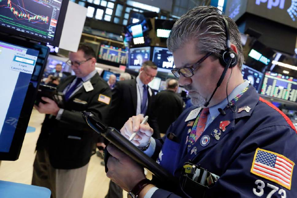 Wage worries sink stocks late
