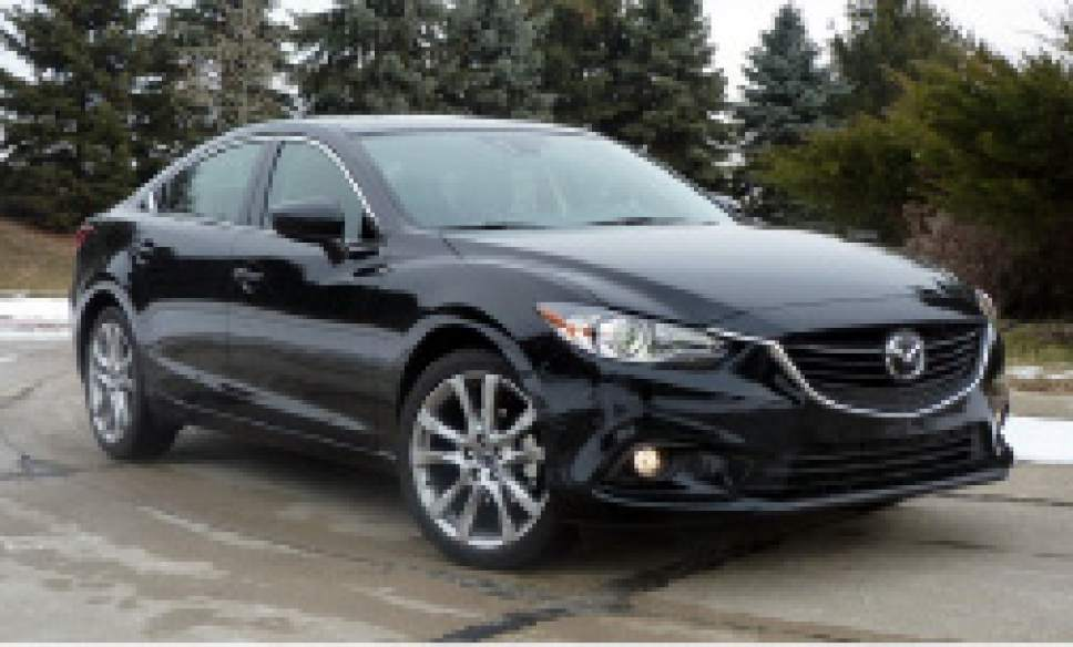 |  Courtesy   South Salt Lake Police said South Jordan resident Matthew Holt was found dead in this model of Mazda sedan, though this is not his vehicle. They are asking for the public's help in finding a suspect.