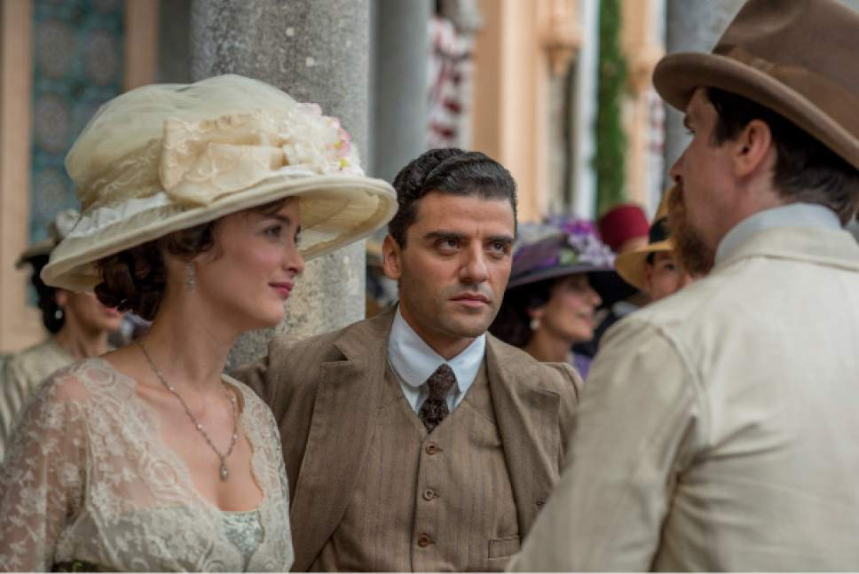 "This image released by Open Road Films shows Charlotte Le Bon, from left, Oscar Isaac and Christian Bale in a scene from ""The Promise."" (Jose Haro/Open Road Films via AP)"