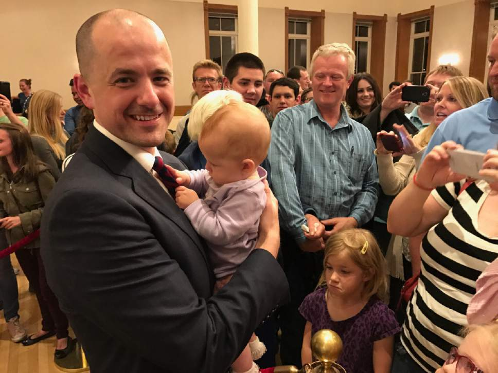    Courtesy of the Evan McMullin campaign  Presidential candidate Evan McMullin mingles with attendees of his town-hall meeting in a Provo library on Wednesday, Oct. 5, 2016.