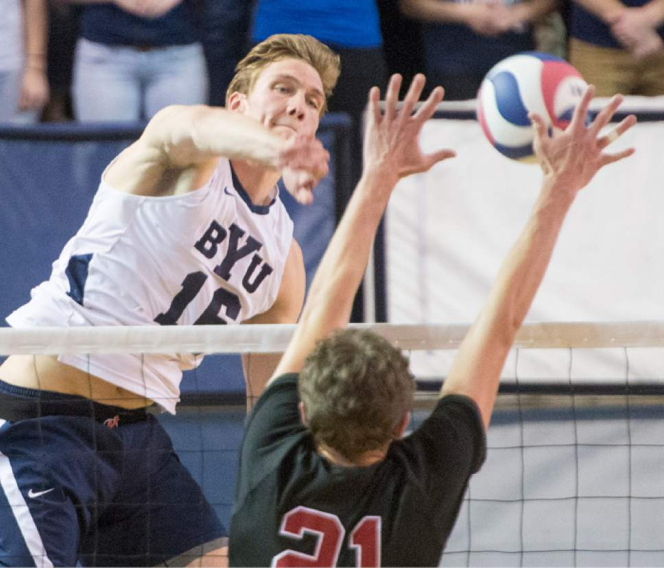 Rick Egan  |  The Salt Lake Tribune BYU's Tim Dobbert, left, had such a good match against Colin McCall, bottom, and Stanford on Saturday that the Cougars were able to give junior All-American Ben Patch more time to rest his groin injury.
