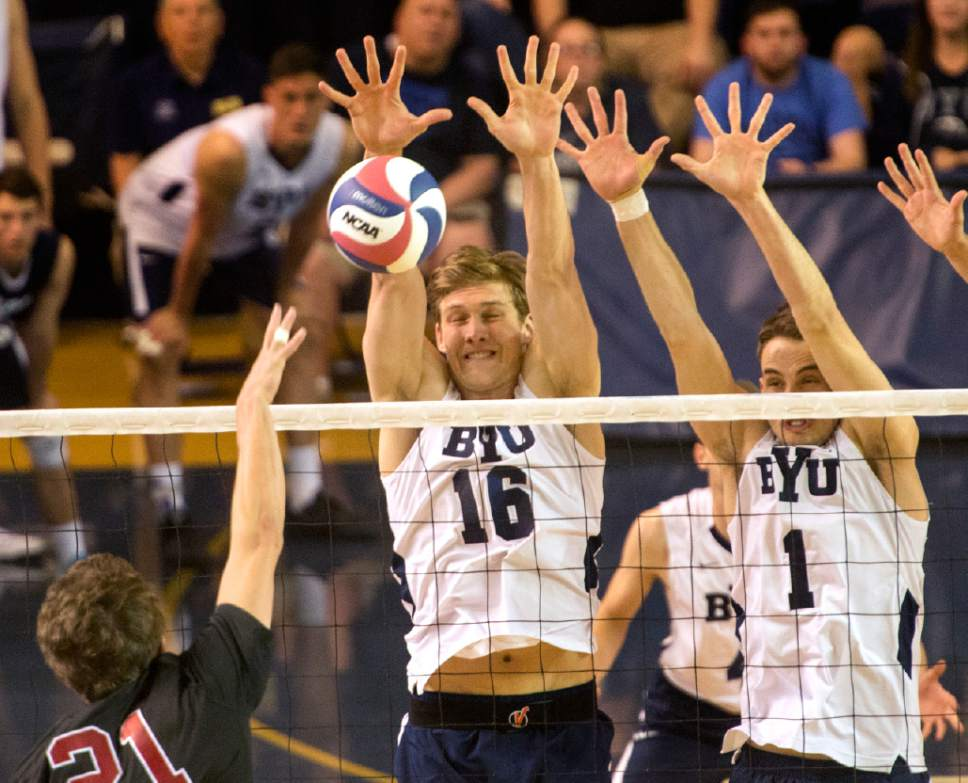 Rick Egan  |  The Salt Lake Tribune   Colin McCall (21) Stanford, tries to get the ball past Tim Dobbert (16) and Price Jarman (1) BYU, in Volleyball action, BYU vs. Stanford, at the Smith Field House in Provo,  Saturday, April 15, 2017.