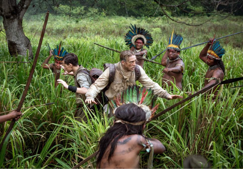 """This image released by Amazon Studios/Bleecker Street Films shows Tom Holland, center left, and Charlie Hunnam, center left, in a scene from """"The Lost City of Z."""" (Aidan Monaghan/Amazon Studios/Bleecker Street via AP)"""