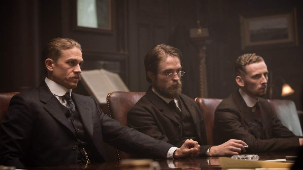 """This image released by Amazon Studios/Bleecker Street Films shows Charlie Hunnam, from left, Robert Pattinson and Edward Ashley in a scene from """"The Lost City of Z."""" (Aidan Monaghan/Amazon Studios/Bleecker Street via AP)"""