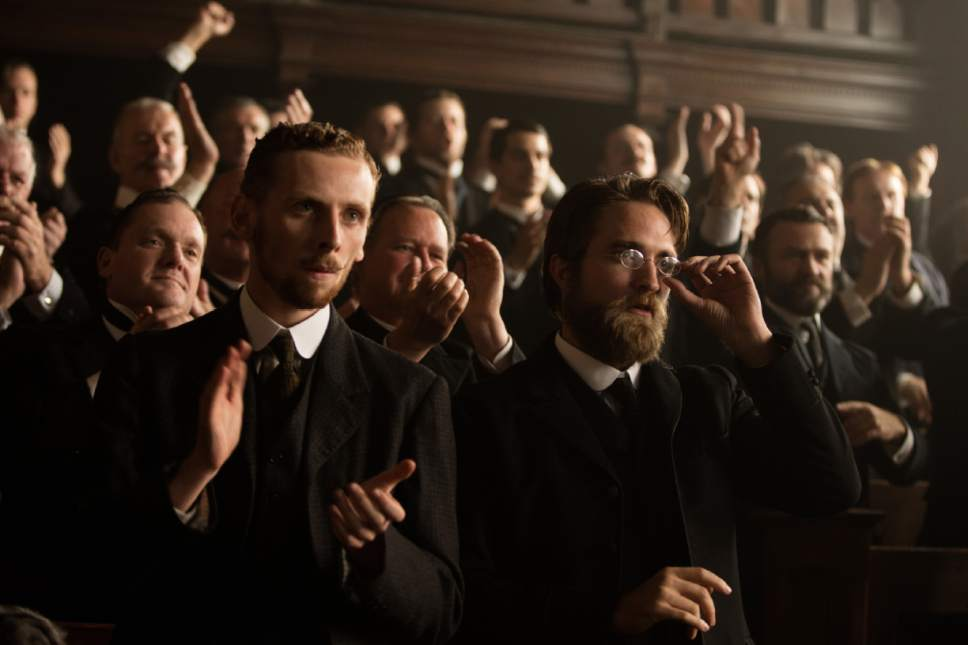 """This image released by Amazon Studios/Bleecker Street Films shows Edward Ashley, left, and Robert Pattinson in a scene from """"The Lost City of Z."""" (Aidan Monaghan/Amazon Studios/Bleecker Street via AP)"""