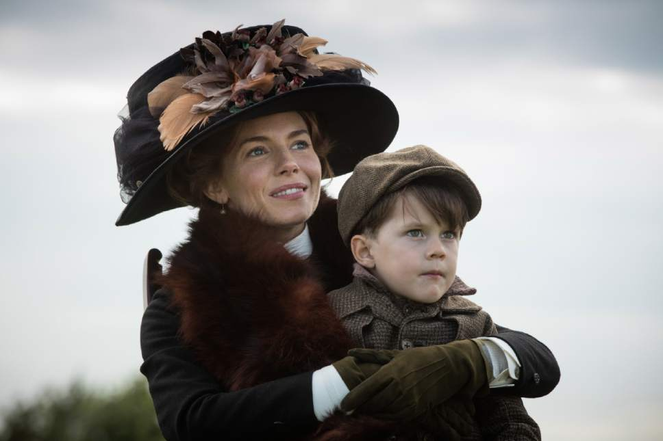 """This image released by Amazon Studios/Bleecker Street Films shows Sienna Miller, left, and Tom Mulheron in a scene from """"The Lost City of Z."""" (Aidan Monaghan/Amazon Studios/Bleecker Street via AP)"""