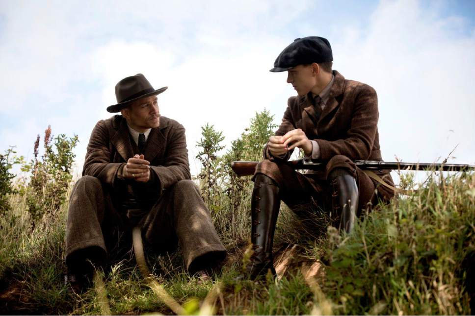 """This image released by Amazon Studios/Bleecker Street Films shows Charlie Hunnam, left, and Tom Holland in a scene from """"The Lost City of Z."""" (Amazon Studios/Bleecker Street via AP)"""