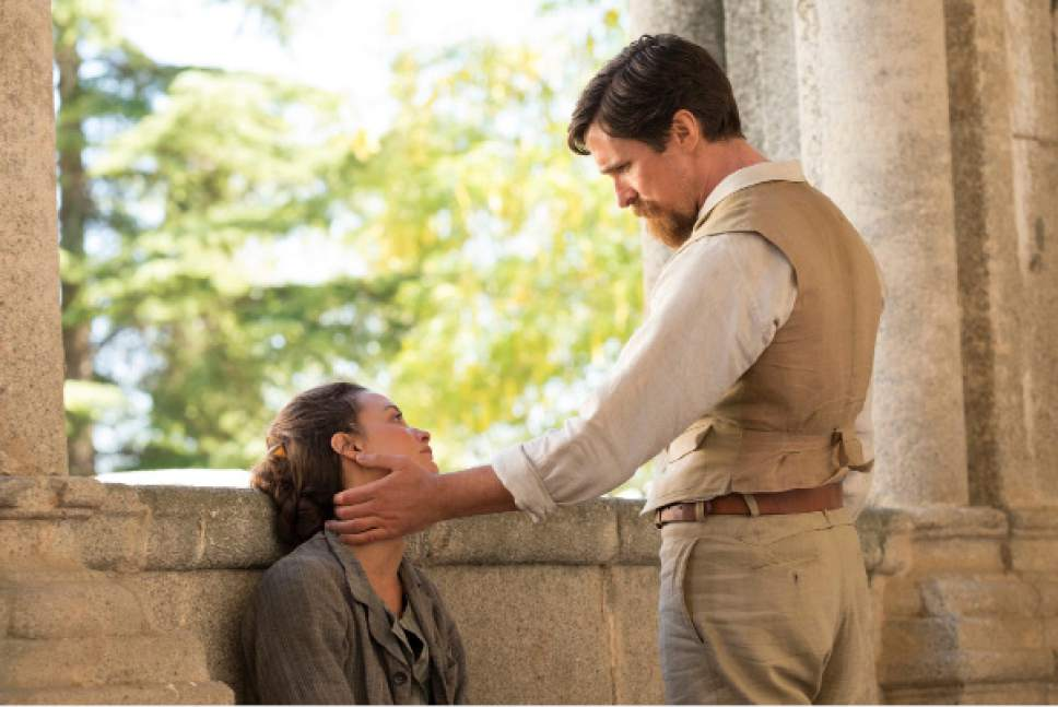"""This image released by Open Road Films shows Charlotte Le Bon, left, and Christian Bale in a scene from """"The Promise."""" (Jose Haro/Open Road Films via AP)"""