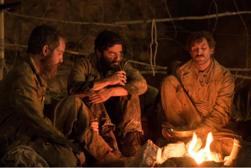"""This image released by Open Road Films shows Oscar Isaac, center, in a scene from """"The Promise."""" (Jose Haro/Open Road Films via AP)"""