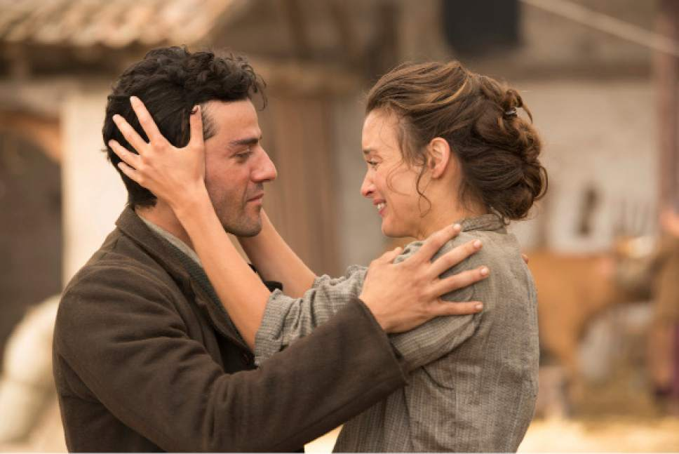 """This image released by Open Road Films shows Oscar Isaac , left, and Charlotte Le Bon in a scene from """"The Promise."""" (Jose Haro/Open Road Films via AP)"""
