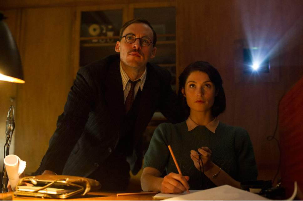 "Screenwriters Tom Buckley (Sam Claflin, left) and Catrin Cole (Gemma Arterton) work on uplifting movies for the British war effort during World War II, in the romantic comedy-drama ""Their Finest."" Nicola Dove  