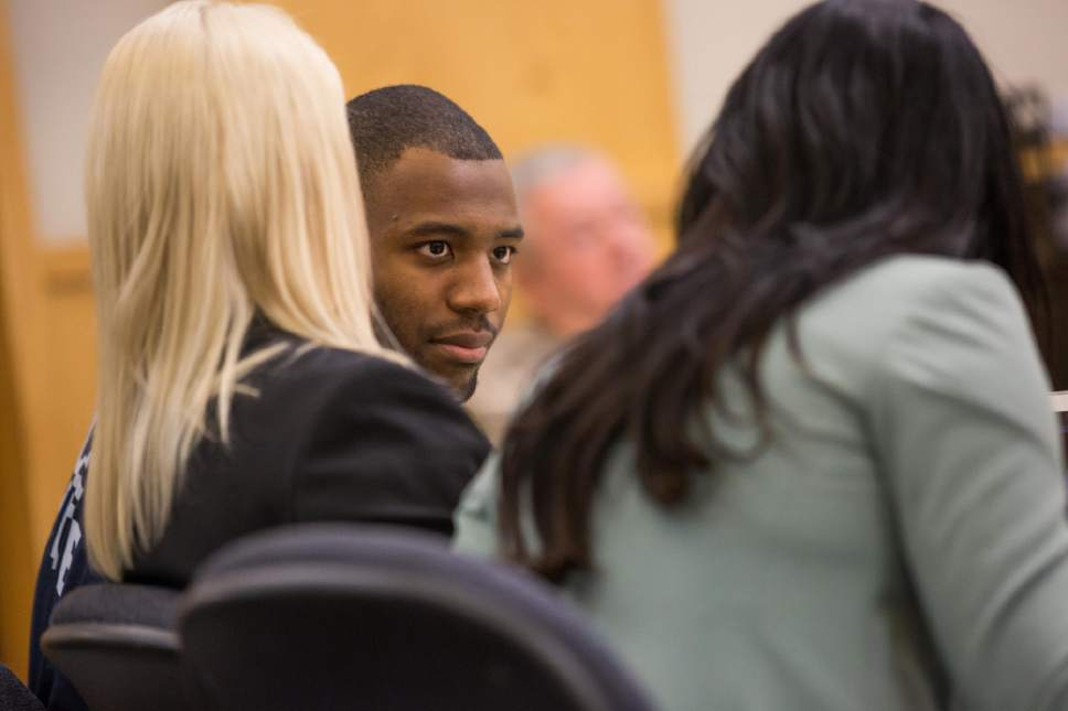 Tim Carpenter  |  Utah Statesman Former Utah State University Linebacker Torrey Green's leans to his defense attorney, Skye Lazaro during closing arguments in 1st District Court in April. A ruling on testimony admissibility in his case led to John Marcus Lowther, who had pleaded no contest to rape charges, to file to withdraw the pleas and challenge testimony against him.