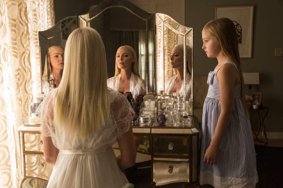 """This image released by Warner Bros. Pictures shows Katherine Heigle, left, and Isabella Kai Rice in a scene from, """"Unforgettable."""" (Karen Ballard/Warner Bros. Pictures via AP)"""