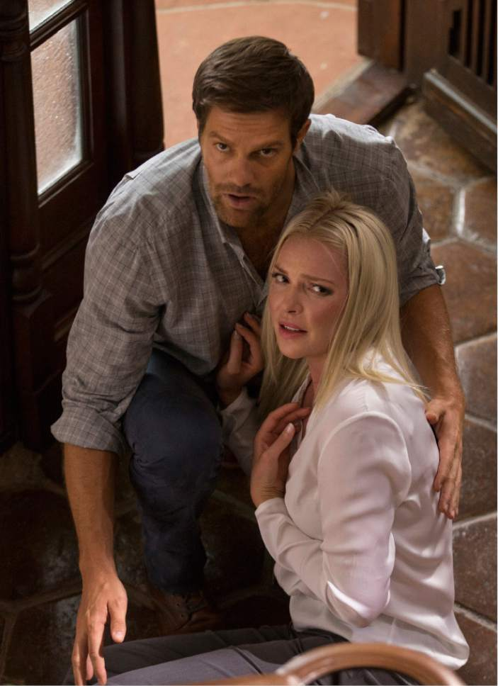 """This image released by Warner Bros. Pictures shows Geoff Stults, left, and Katherine Heigle in a scene from, """"Unforgettable."""" (Karen Ballard/Warner Bros. Pictures via AP)"""