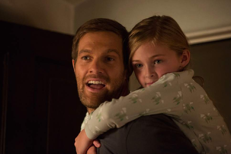"""This image released by Warner Bros. Pictures shows Geoff Stults, left, and Isabella Kai Rice in a scene from, """"Unforgettable."""" (Karen Ballard/Warner Bros. Pictures via AP)"""