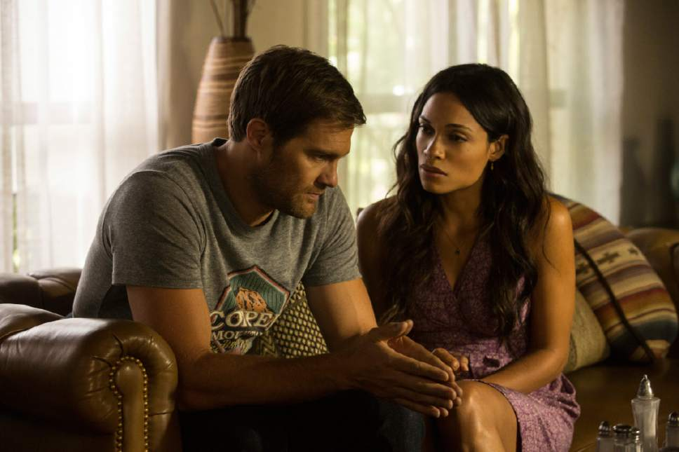 """This image released by Warner Bros. Pictures shows Geoff Stults, left, and Rosario Dawson in a scene from, """"Unforgettable."""" (Karen Ballard/Warner Bros. Pictures via AP)"""