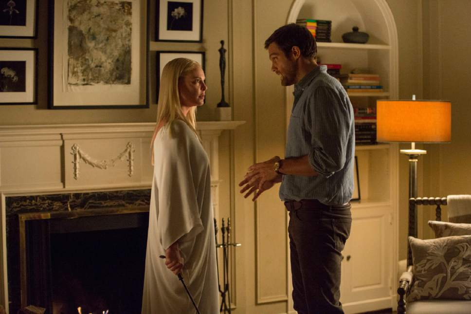 """This image released by Warner Bros. Pictures shows Katherine Heigle and Geoff Stults in a scene from, """"Unforgettable."""" (Karen Ballard/Warner Bros. Pictures via AP)"""