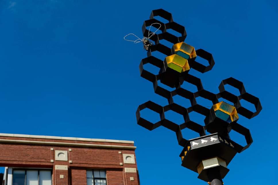 Trent Nelson     The Salt Lake Tribune The Salt Lake City Public Art Program spent the day installing the permanent Flying Objects public art sculpture series along 300 South in downtown Salt Lake City, Saturday April 15, 2017.