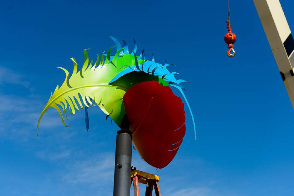 """Trent Nelson     The Salt Lake Tribune Greg Ragland's piece """"Feathers in the Wind"""" is removed from its perch along 300 South in Salt Lake City, Saturday April 15, 2017. The Salt Lake City Public Art Program spent the day installing the permanent Flying Objects public art sculpture series. The temporary series of Flying Objects, now removed, was installed in 2014 and the sculptures are currently for sale through the artists."""