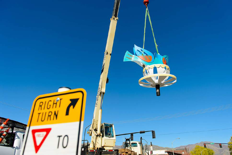 """Trent Nelson     The Salt Lake Tribune Traci O'very Covey's piece """"Drinking it In"""" is installed at 300 South and 300 East in Salt Lake City, Saturday April 15, 2017. The Salt Lake City Public Art Program spent the day installing the permanent Flying Objects public art sculpture series. The previous series of Flying Objects, now removed, was installed in 2014 and the sculptures are currently for sale through the artists."""
