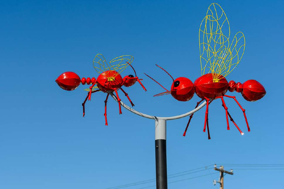 Trent Nelson  |  The Salt Lake Tribune The Salt Lake City Public Art Program spent the day installing the permanent Flying Objects public art sculpture series along 300 South in downtown Salt Lake City, Saturday April 15, 2017.