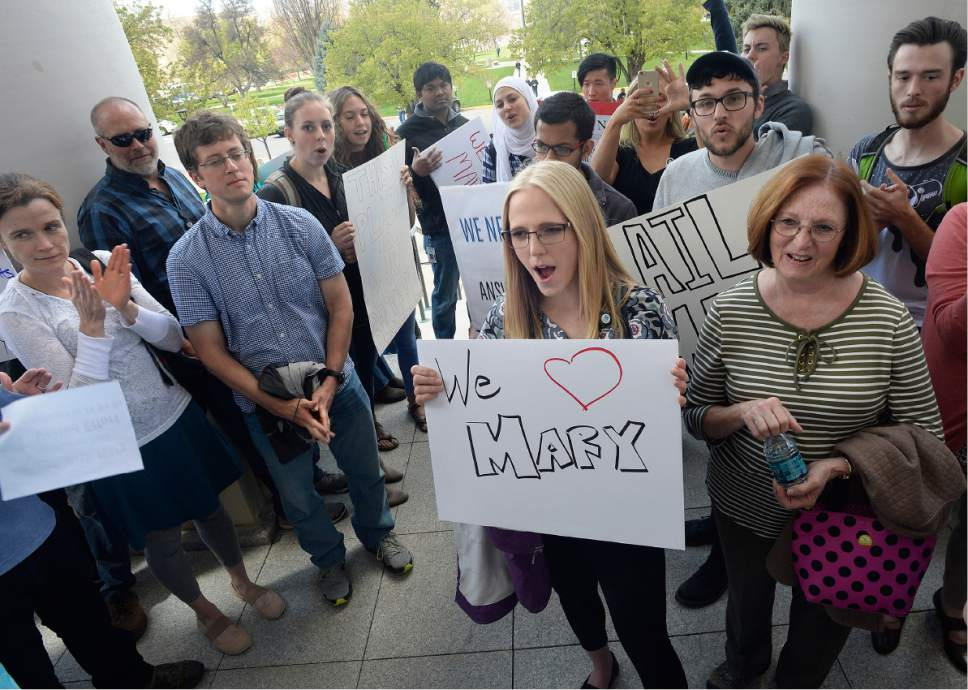 Scott Sommerdorf | The Salt Lake Tribune Huntsman Cancer Institute faculty cheer after it was announced that their petition protesting the firing of HCI CEO Mary Beckerle was delivered to Vivian Lee's office, Wednesday, April 19, 2017.