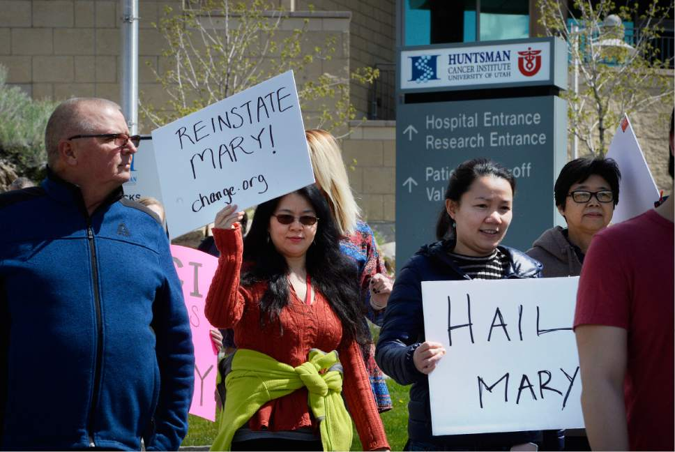 Scott Sommerdorf | The Salt Lake Tribune Huntsman Cancer Institute faculty protest the firing of Institute CEO Mary Beckerle as they march to Vivian Lee's office, Wednesday, April 19, 2017.