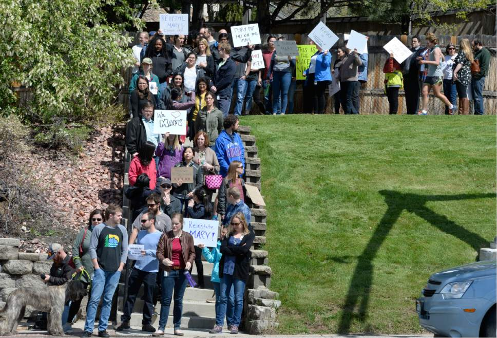 Scott Sommerdorf | The Salt Lake Tribune Huntsman Cancer Institute faculty protest the firing of Institute CEO Mary Beckerle as they march from the HCI to President's Circle to deliver their petition to Vivian Lee's office, Wednesday, April 19, 2017.