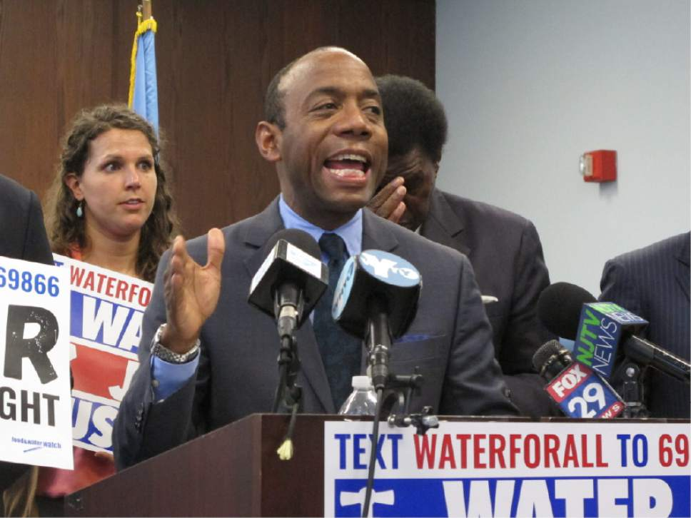 Cornell Brooks, national president of the NAACP, speaks at a news conference in Atlantic City N.J. on Thursday April 20, 2017 at which he and others vowed to try to block a proposed privatization of the city's water system. The civil rights leader spoke hours after Gov. Chris Christie said his administration's takeover of Atlantic City's powers, which enables it to seize and sell city assets, is showing benefits. (AP Photo/Wayne Parry)