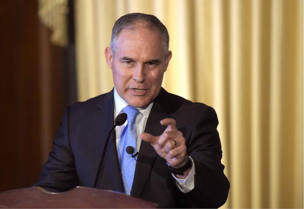 """FILE - In this Feb. 21, 2017, file photo, Environmental Protection Agency (EPA) Administrator Scott Pruitt speaks to employees of the EPA in Washington. Dow Chemical is pushing the Trump administration to scrap the findings of federal scientists who point to a family of widely used pesticides as harmful to about 1,800 critically threatened or endangered species. Lawyers representing Dow and two other makers of organophosphates sent letters last week to the heads of three Cabinet agencies. The letters, obtained by The Associated Press, show the companies asked them """"to set aside"""" the results of government studies.  (AP Photo/Susan Walsh, File)"""