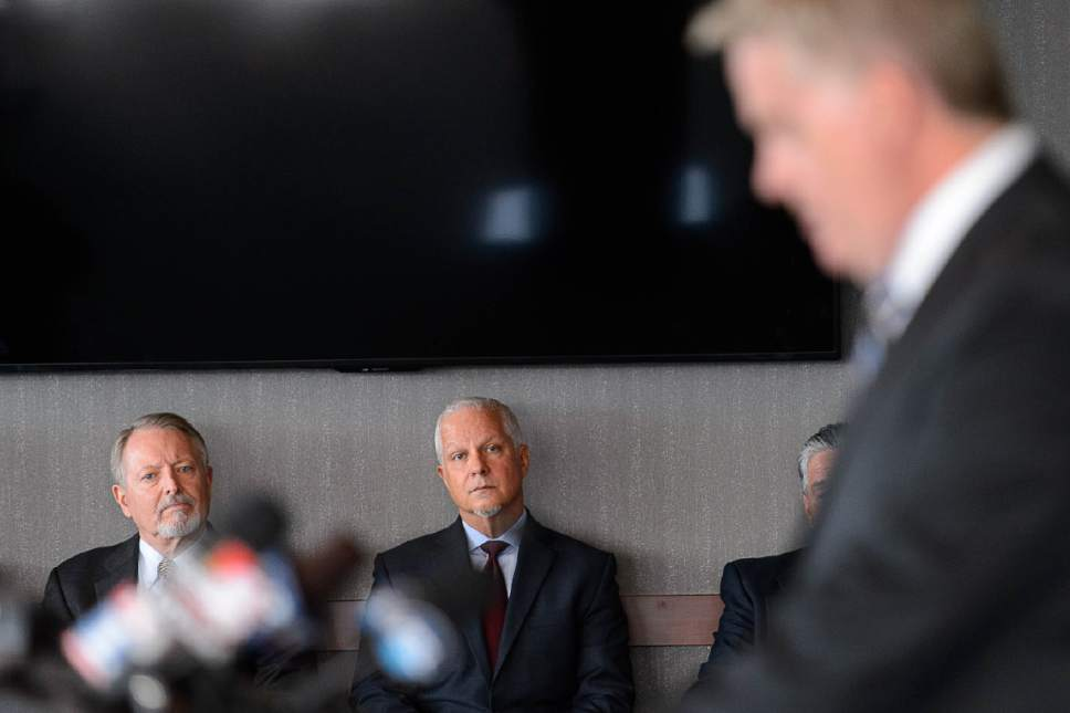 Trent Nelson  |  The Salt Lake Tribune Utah Transit Authority's Robert McKinley and Jerry Benson look on as U.S. Attorney John W. Huber announces an investigation into UTA at a news conference in Salt Lake City, Tuesday April 4, 2017.